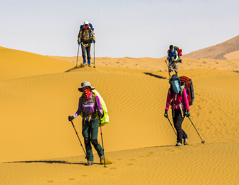 Brave hikers in Badain Jaran Desert