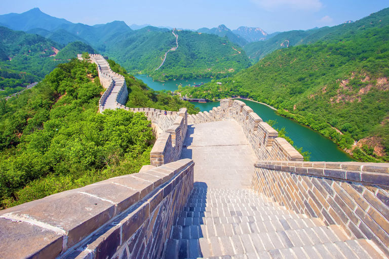 Huanghuacheng Great Wall rises up from a beautiful lake