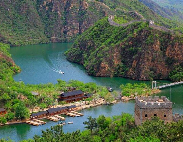 Leisure boat cruise on the lake at the foot of Huanghuacheng Great Wall