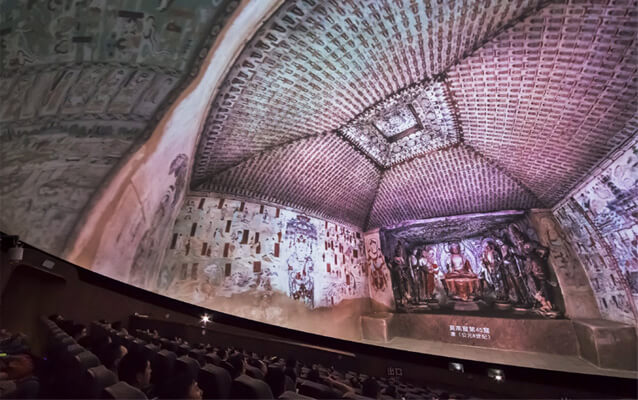 Watch a documentary film in the Dome Theater of Mogao Grottoes Digital Exhibition Center