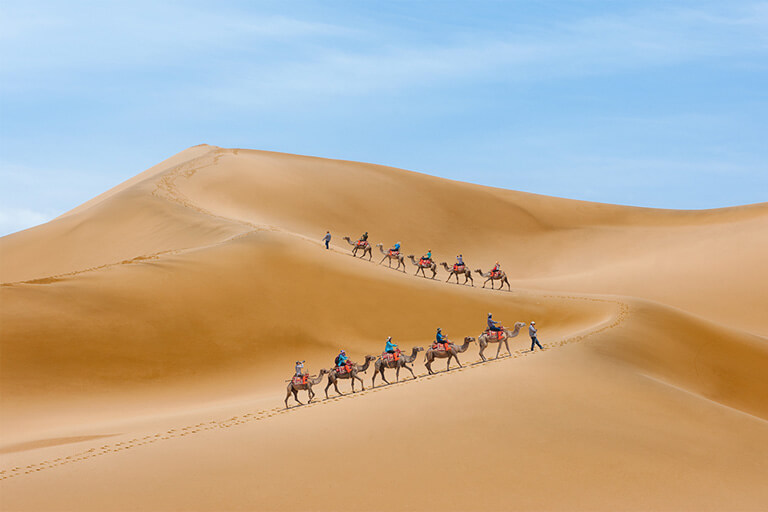Riding Camel at Mingshashan (Echoing Sand Mountains)