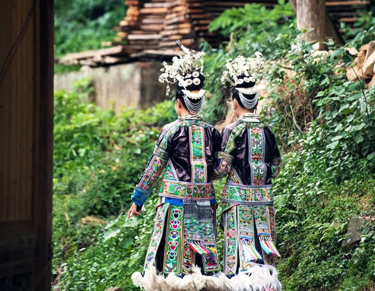 Girls at Baibei Miao Village Wearing theirBeautiful Hundred-bird Dress