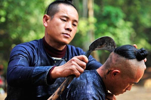 Shaving Hairs with Sickle in Basha Miao Village