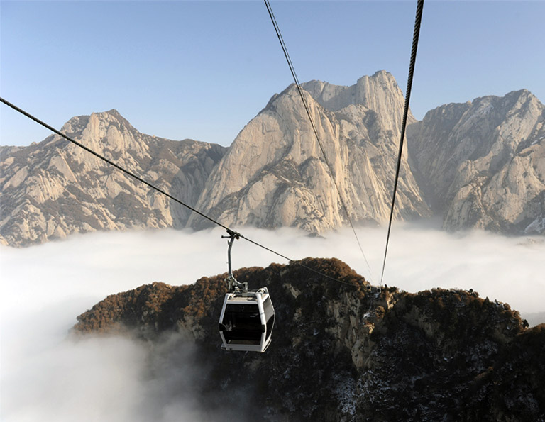 West Peak Cableway Hanging over 900 meters above the valley