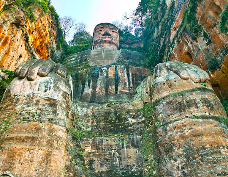 Look up at Leshan Giant Buddha from its foot stage