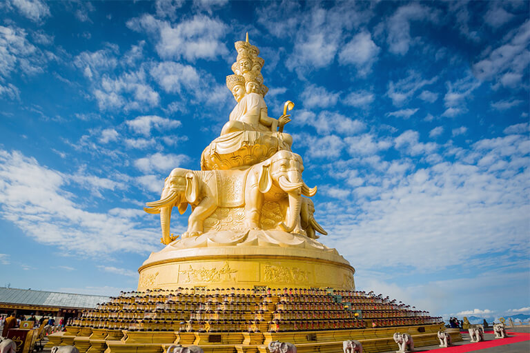 The multi-faced golden statue (48m) of Samantabhadra Bodhisattva at Golden Summit