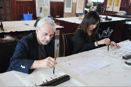 Senior Traveler Practising Calligraphy