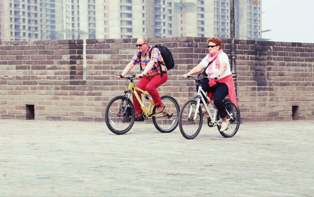Visitor Riding on Ancient City Wall