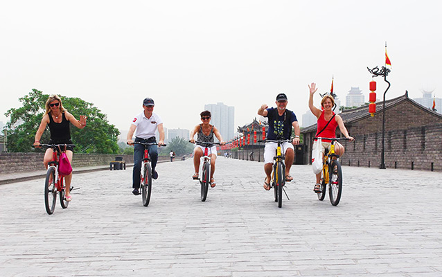 Our guests biking on the Ancient City Wall
