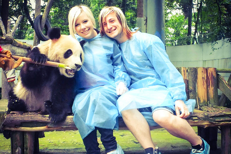Volunteers Holding Giant Panda at Bifengxia