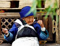 Old Naxi Woman in Lijiang Ancient Town
